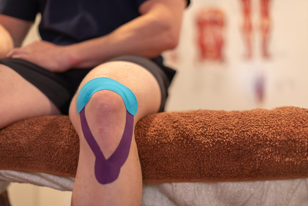 Kinesio Taping for knee injury in osteopathy and remedial massage