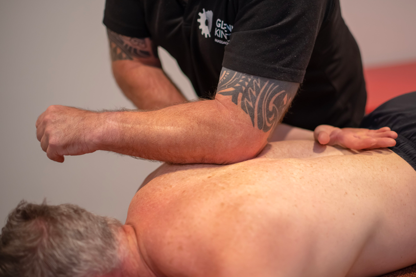 Active release technique by massage therapist on patients back