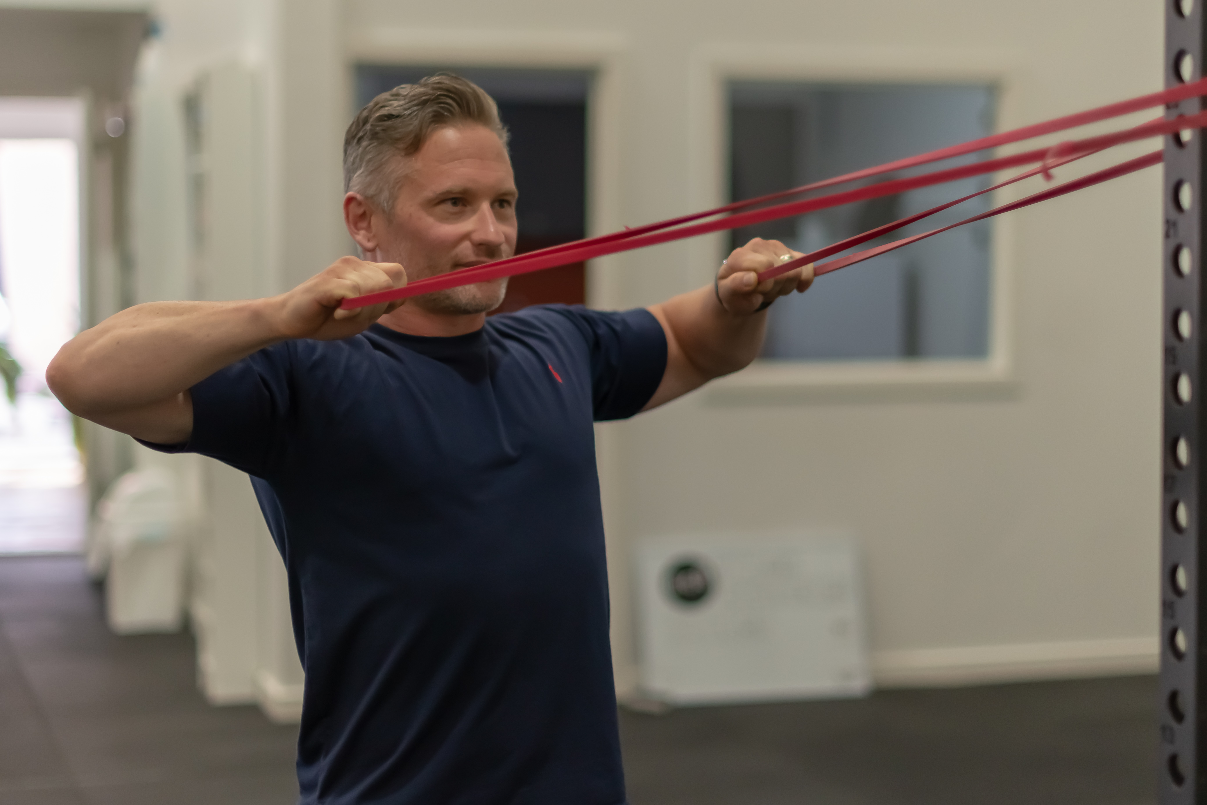 Osteopath - resistance band exercise.