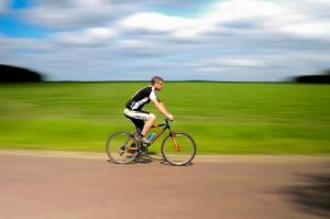 man riding a bike on road